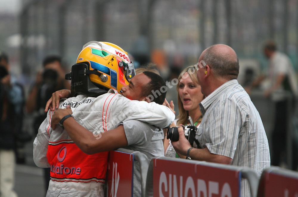Lewis Hamilton (McLaren-Mercedes) celebrates with his brother and mother after the 2008 Chinese Grand Prix at the Shanghai International Circuit. Photo: Grand Prix Photo