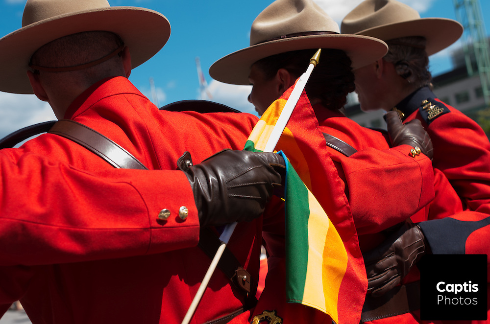 Members of the RCMP in dress uniform pose for photos during the parade. August 24, 2014.