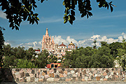 Domes and spires of the Parroquia San Miguel Arcangel church in the historic district of San Miguel de Allende, Mexico.