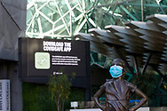 """A view of the """"Fearless Girl' standing more fearful as she wears a mask in Federation Square with a COVID-19 ad in the background during COVID-19 in Melbourne, Australia. Hotel quarantine linked to 99% of Victoria's COVID-19 cases, inquiry told. This comes amid a further 222 new cases being discovered along with 17 deaths. Melbourne continues to reel under Stage 4 restrictions with speculation that it will be extended. (Photo by Dave Hewison/Speed Media)"""