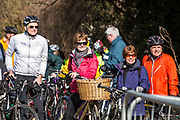 A group of happy male and female cyclists gather at the Devonshire Tunnel entrance for the official opening of the Bath Two Tunnels on 6th April 2013. The iconic tunnels provide a fantastic walking and cycling link between Central Bath, Midford, Monkton Combe and beyond.  The restoration of these tunnels has opened up a 13 mile circular route from the centre of Bath that takes in National Cycle Route 24, National Route 4 and the spectacular Dundas Aqueduct on the Kennet & Avon Canal.  This development was started by a local community group and is part of the Sustrans lottery-funded project, Connect 2 Cycling Network.  Hundreds of people attended the event. Bath, England, United Kingdom.