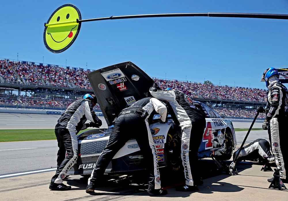 May 7, 2017; Talladega, AL, USA; The crew of NASCAR Cup Series driver Kevin Harvick (4) looks under his hood during the GEICO 500 at Talladega Superspeedway. Mandatory Credit: Peter Casey-USA TODAY Sports