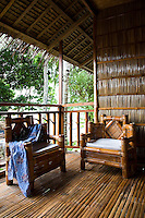 Tropical Veranda at El Galleon Resort, Puerto Galera, The Philippines.  As with most beach towns in the Philippines, much use is made of natural local materials such as bamboo and coconuts which is not only economical but keeps cool in hot humid weather as well.