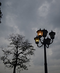 July 13, 2017 - Lahore, Punjab, Pakistan - An eye catching view of dark clouds hovering over the sky while families enjoying the pleasant weather in greater Iqbal Park in Lahore. As weather turned pleasant after rain in Provincial Capital. (Credit Image: © Rana Sajid Hussain/Pacific Press via ZUMA Wire)