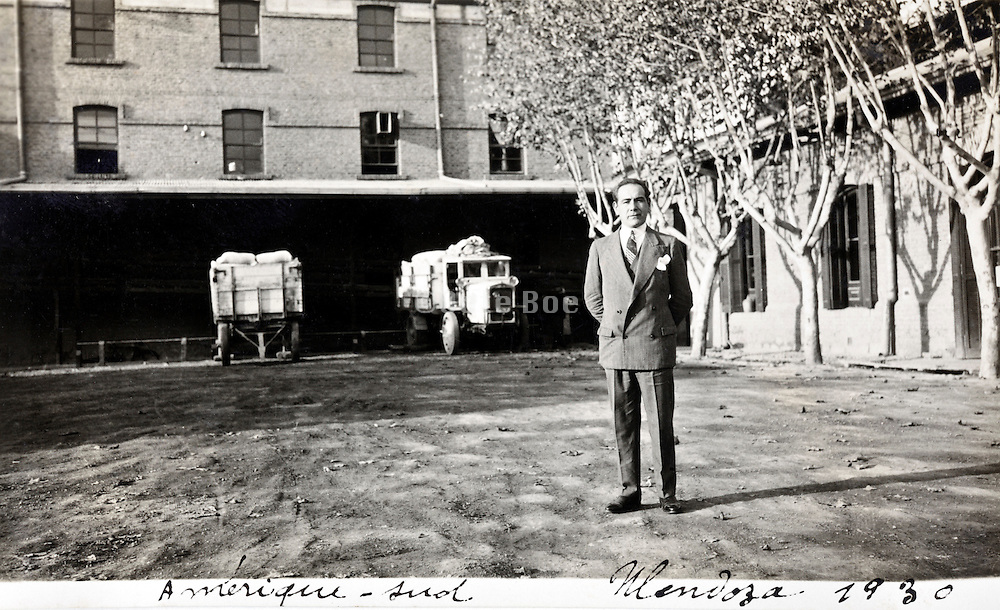 man standing with truck in the background 1930