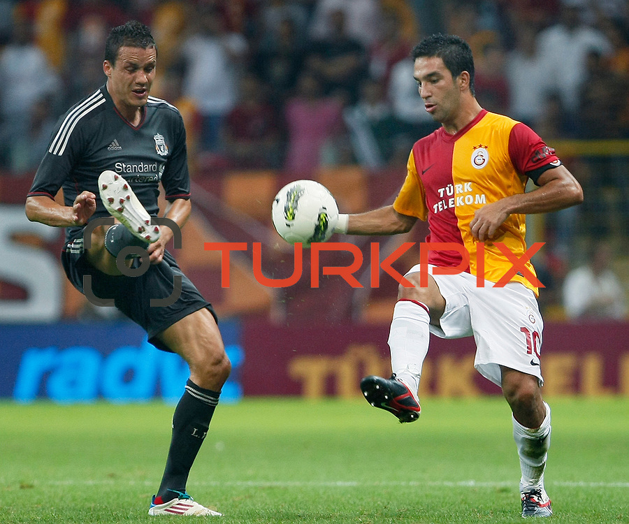 Galatasaray's Arda TURAN (R) during their Friendly soccer match Galatasaray between Liverpool at the TT Arena at Arslantepe in Istanbul Turkey on Saturday 28 July 2011. Photo by TURKPIX