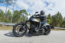 Karen Davidson on the MDA Women's ride after leaving the Harley footprint at Daytona International Speedway. Daytona Bike Week 75th Anniversary event. FL, USA. Tuesday March 8, 2016.  Photography ©2016 Michael Lichter.