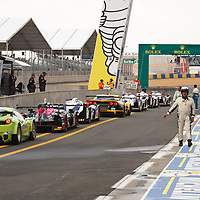 The cars line up in the pit lane awaiting the green light for the start of practice at Le Mans 24H 2013