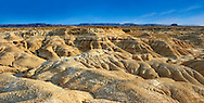 Bardena Blanca rock formations Bardenas Reales de Navarra Natural Park. A UNESCO World Heritage Site . The Bardenas Reales (sometimes referred as Bárdenas Reales) is a semi-desert natural region, or badlands, of some 42,000 hectares (420 km2; 104,000 acres) in southeast Navarre (Spain). The soils are made up of clay, chalk and sandstone and have been eroded by water and wind creating surprising shapes, canyons, plateaus, tabular structures and isolated hills, called cabezos. Bardenas Reales lacks urban areas, vegetation is scarce and the many streams that cross the territory have a markedly seasonal flow, staying dry most of the year.<br /> <br /> Visit our SPAIN HISTORIC PLACES PHOTO COLLECTIONS for more photos to download or buy as wall art prints https://funkystock.photoshelter.com/gallery-collection/Pictures-Images-of-Spain-Spanish-Historical-Archaeology-Sites-Museum-Antiquities/C0000EUVhLC3Nbgw