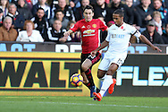 Wayne Routledge of Swansea city ® goes past Matteo Darmian of Manchester Utd.   Premier league match, Swansea city v Manchester Utd at the Liberty Stadium in Swansea, South Wales on Sunday 6th November 2016.<br /> pic by  Andrew Orchard, Andrew Orchard sports photography.