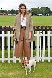 ASTRID MUNOZ and her dog Egor at the Cartier Queen's Cup Final polo held at Guards Polo Club, Smith's Lawn, Windsor Great Park, Egham, Surrey on 15th June 2014.