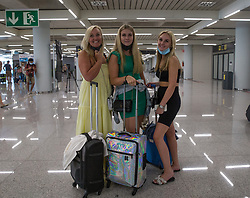 © Licensed to London News Pictures.  30/06/2021. Palma de Mallorca, Spain. Kelly Leila and Grace from London arrive at Palma Airport in Mallorca as Balearic Islands are on the UK 'green list' from 4am, today. Photo credit: Marcin Nowak/LNP