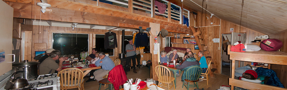 This scene is at Mount Tahoma Trails Association's High Hut cabin after dinner during  a weekend work party of volunteers. Mount Tahoma Trails Association maintains and manages the Mount Tahoma Trails cross country ski and snowshoe trail system in the Cascade Mountain Range of Washington state. panorama