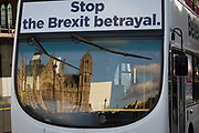 As Prime Minister Theresa May tours European capitals hoping to persuade foreign leaders to accept a new Brexit deal (following her cancellation of a Parliamentary vote), a pro-EU Remain-sponsored bus drives past the protest opposite the Houses of Parliament, on 11th December 2018, in London, England.
