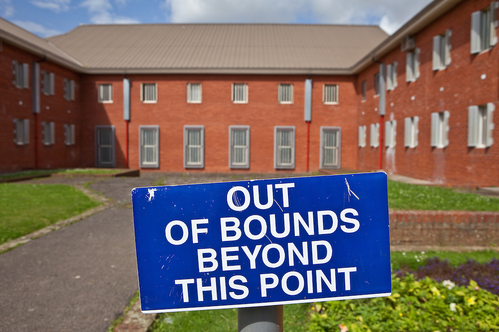 A sign at the entrance to a courtyard outside some of the residential wings. HMP The Mount, Bovingdon, Hertfordshire