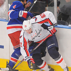 April 30, 2012: New York Rangers defenseman Michael Del Zotto (4) and Washington Capitals center Jay Beagle (83) battle for the puck against the boards during first period action in Game 2 of the NHL Eastern Conference Semifinals between the Washington Capitals and New York Rangers at Madison Square Garden in New York, N.Y.