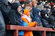 Blackpool fans keeping warm during the EFL Sky Bet League 1 match between Fleetwood Town and Blackpool at the Highbury Stadium, Fleetwood, England on 25 November 2017. Photo by Paul Thompson.