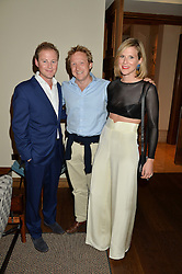 Left to right, GUY PELLY, OLLY HICKS and LIZZIE PELLY at a private view of the Beulah Winter Autumn Winter collection entitled 'Chrysalis' held at The South Kensington Club, London SW7 on 24th September 2015.