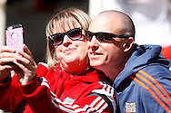 Brentford fans taking a selfie pre kick off. Skybet football league championship match, Brentford  v Fulham at Griffin Park in London on Saturday 30th April 2016.<br /> pic by Steffan Bowen, Andrew Orchard sports photography.