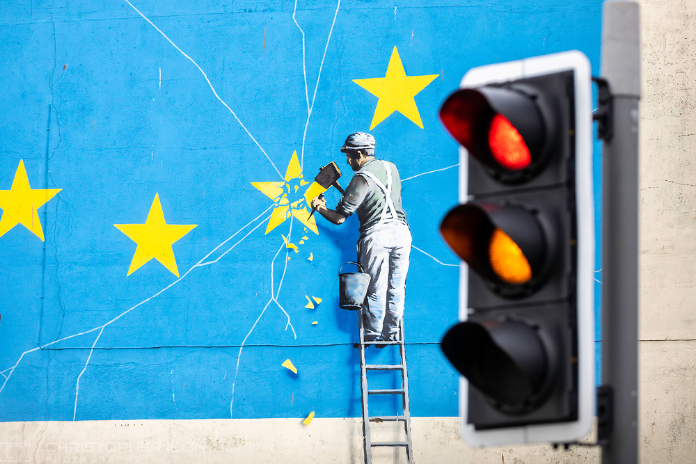 What next for Brexit??<br /> A traffic light signals red and amber beside Banksy's famous Brexit mural on the side of a derelict building in Dover. <br /> Prime Minister Theresa May is meeting European leaders today to ask for an extension in the hope of avoiding a no-deal Brexit. <br /> Picture date Wednesday 10th April, 2019.<br /> Picture by Christopher Ison. Contact +447544 044177 chris@christopherison.com