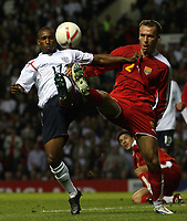 Photo: Paul Thomas.<br /> England v Macedonia. UEFA European Championships 2008 Qualifying. 07/10/2006.<br /> <br /> Jermain Defoe (L) of England battles with Nikolce Noveski.