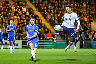 Colchester United defender Luke Prosser (5) clears the ball before Tottenham Hotspur midfielder Dele Alli (20) comes in  during the EFL Cup match between Colchester United and Tottenham Hotspur at the JobServe Community Stadium, Colchester, England on 24 September 2019.
