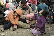 March 1, 2016 - Athens, Greece - <br /> <br /> Greece/Macedonia border Idomeni/Gevgelija  march 2,  2016.thousands of migrants  are stuck at the border between Greece and Macedonia where only the Syrians and the Iraqis can pass. Only a few people every day can pass, around 150, causing the filling of the field . 10,000 people are now on the border , in desperate conditions . Each time it is announced the opening of the border police has to keep crowds of people.<br /> ©Exclusivepix Media