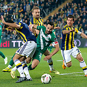 Fenerbahce's Bekir Irtegun (L), Caner Erkin (B), Emre Belozoglu (R) and Bursaspor's Volkan Sen (C) during their Turkish superleague soccer match Fenerbahce between Bursaspor at the Sukru Saracaoglu stadium in Istanbul Turkey on Monday 20 April 2015. Photo by Kurtulus YILMAZ/TURKPIX