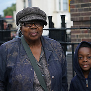 Tottenham cPolice Station, London, UK. 4th August 2017. Joy Gardner mum and her grandson attend Justice for Mark Duggan protest march for the 6th Anniversary Vigil.