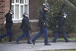 CAPTION CORRECTION © Licensed to London News Pictures. 09/03/2021. London, UK. A police search team are seen at a block of flats in the Clapham area as officers continue to look for missing 33 year old woman Sarah Everard. Police are concerned for the safety of Ms Everard who has been missing for six days after leaving a friend's house in Leathwaite Road, Clapham, London. She is thought to have walked across Clapham Common, and was due to arrive home in Brixton 50 minutes later. Photo credit: Peter Macdiarmid/LNP