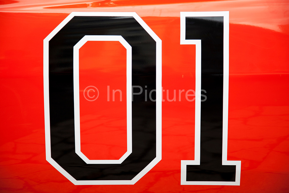 Detail of the famous car used in the hit American movie and tv show The Dukes of Hazard. This car, a 2 door coupe style muscle car, was the Chrysler produced Dodge Charger. The General Lee as that car was known was adorned with the number 01.