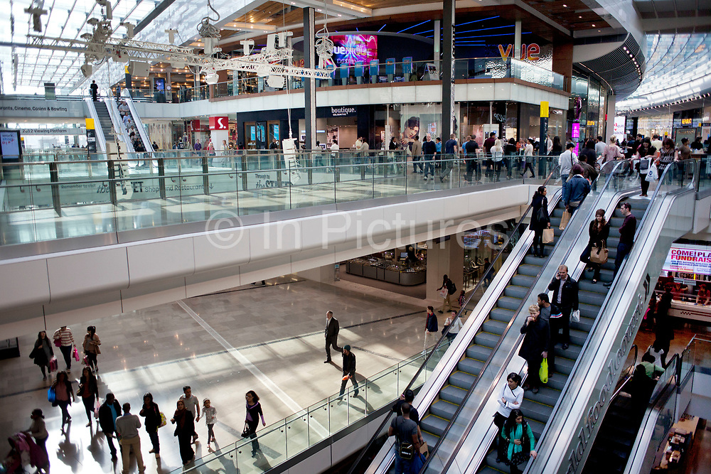 Scene inside the new Westfield Shopping Centre in Stratford, East London, UK. This is Europe's largest shopping complex. This is a poor area of London, but in recent years has seen much regeneration, the construction of a major transport hub and various shopping complexes. Many local people are angry at this centre though which has very expensive high end shops inside, way beyond the budgets of many local people. Stratford is adjacent to the London Olympic Park and is currently experiencing regeneration and expansion linked to the 2012 Summer Olympics.