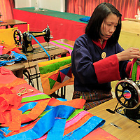 Asia, Bhutan, Thimpu. Sewing Student at the National Institute for Zorig Chusum, or traditional arts and crafts.