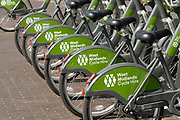 West Midlands Cycle Hire bicycles at a docking station in the UK City of Culture 2021 on 23rd June 2021 in Coventry, United Kingdom. This scheme is available across the West Midlands, including Birmingham, Coventry, Sandwell, Stourbridge, Solihull, Sutton Coldfield, Walsall and Wolverhampton. The UK City of Culture is a designation given to a city in the United Kingdom for a period of one year. The aim of the initiative, which is administered by the Department for Digital, Culture, Media and Sport. Coventry is a city which is under a large scale and current regeneration.