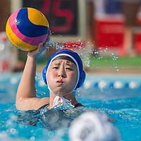 Teng Fei of China passes the ball during the women waterpolo friendly match of Hungary and China in Tatabanya, Hungary on June 23, 2012. ATTILA VOLGYI