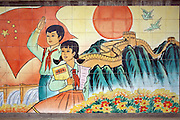 A mural depicting Chinese children, their National flag and the Great Wall decorates the exterior of a kindergarten in the primarily Muslim town of Minfeng in China's western Xinjiang Province.