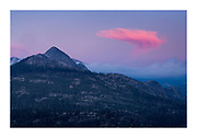 Beautiful pink Sky with interesting shaped cloud taken from Glacier Point at sunset, Yosemite, National Park, California