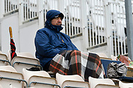 A spectator wrapped up warm with a blanket as he awaits the start of play during the first day of the Specsavers County Champ Div 1 match between Hampshire County Cricket Club and Essex County Cricket Club at the Ageas Bowl, Southampton, United Kingdom on 5 April 2019.
