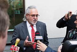 © Licensed to London News Pictures. 10/12/2018. London, UK.  Entrepreneur, Vijay Mallya takes a break from court and speaks to journalists at  Westminster Magistrates Court to hear senior district judge Emma Arbuthnot return her decision on whether Mallya, the chairman of United Breweries Group and co-owner of the Force India F1 team should be extradited over allegations of fraud.  Photo credit: Vickie Flores/LNP