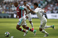 Andre Ayew of West Ham United (L) in action with Kyle Naughton of Swansea City (R). Premier league match, West Ham Utd v Swansea city at the London Stadium, Queen Elizabeth Olympic Park in London on Saturday 8th April 2017.<br /> pic by Steffan Bowen, Andrew Orchard sports photography.