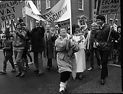 "Irish Theatre Industry Protest at Leinster House.1983.07.12.1983.12.07.1983.7th December 1983...With the imposition of a 23% V.A.T.rate on theatre tickets, the theatre industry was feeling the strain. Maureen potter and Brendan Grace aka ""Bottler"" led the protest to the gates of Leinster House Dublin..Photo of Maureen  in determined mode leading the protest.Among the ""cast"" is the entertainer Tony Kenny,to her left."