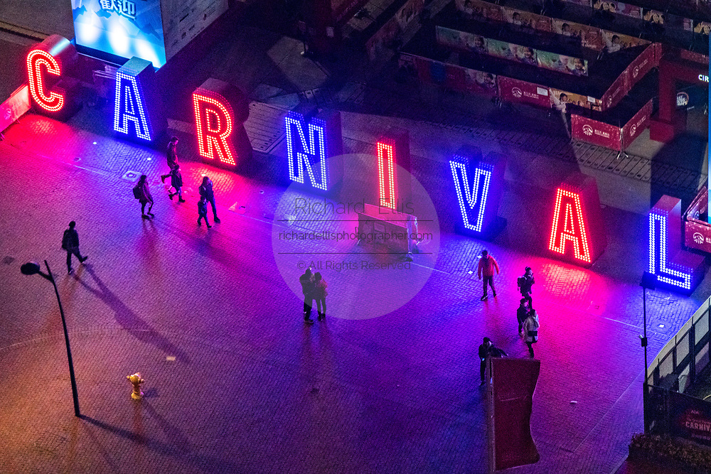 Neon sign marking the entrance to the annual winter carnival at the AIA Vitality Park in the Central District of Hong Kong.