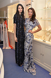 Left to right, AMY PETERSON and JO RENWICK at a preview of the latest collections by jewellery designer Kiki Mcdonough and fashion label Beulah held at Kiki McDonough Jewellery, 12 Symons Street, London on 5th March 2014.