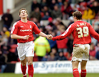 Photo: Leigh Quinnell.<br /> Nottingham Forest v Swindon Town. Coca Cola League 1. 25/02/2006. Nicky Southall celebrates his goal with Notingham Forest team mate Grant Holt.