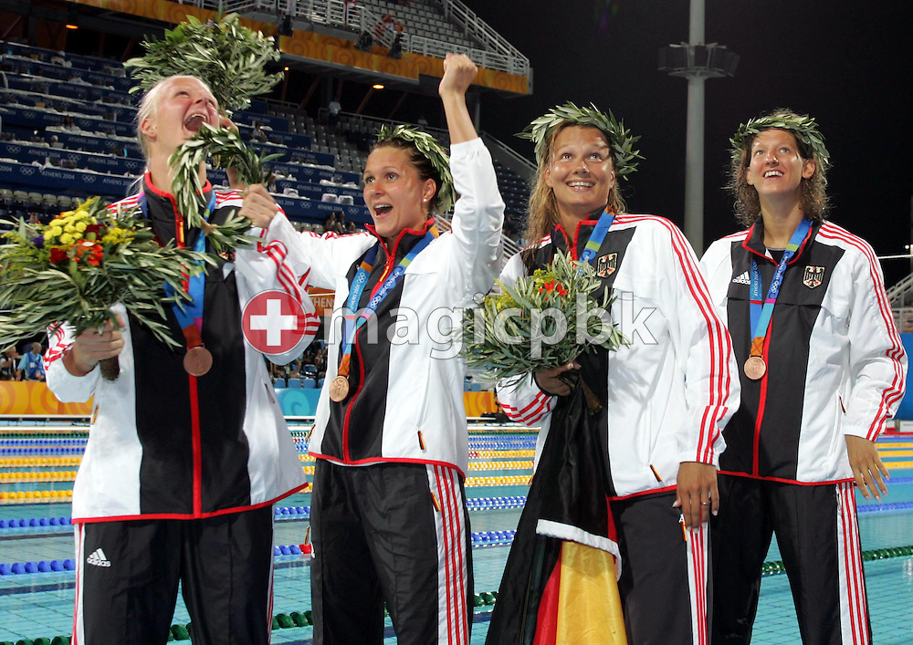 German swimmers Petra Dallmann, Hannah Stockbauer, Franziska van Almsick and Antje Buschschulte (L to R) jubilate with their medals after taking the Bronze in the women's 4x200m Freestyle Relay final at the Athens Olympic Aquatic Centre, Wednesday 18 August 2004. The US team set a new wolrd record in 7:52.42 in this race.  .  (Photo by Patrick B. Kraemer / MAGICPBK)