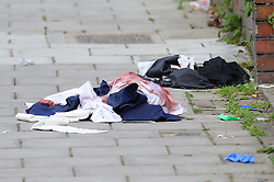 © Licensed to London News Pictures. 08/06/2018. London, UK. Blood soaked clothing is seen on Amesbury Avenue in Streatham Hill, south London, where it is reported that a young man has been stabbed. Photo credit: Rob Pinney/LNP