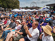 17 AUGUST 2019 - DES MOINES, IOWA: Iowa State Fair goers listen to Representative Seth Moulton at the Des Moines Register Political Soapbox. Moulton, a US Marine veteran who served in Iraq, is running to be the Democratic candidate for the US Presidency in 2020. Iowa traditionally hosts the the first selection event of the presidential election cycle. The Iowa Caucuses will be on Feb. 3, 2020.         PHOTO BY JACK KURTZ