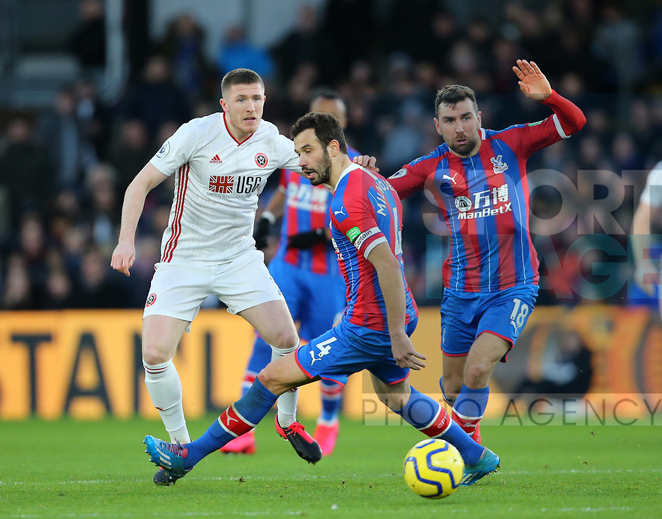 John Lundstram of Sheffield Utd  threads a pass through two Palace players during the Premier League match at Selhurst Park, London. Picture date: 1st February 2020. Picture credit should read: Paul Terry/Sportimage
