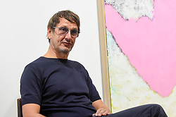 """© Licensed to London News Pictures. 04/09/2018. LONDON, UK. German artist Daniel Richter poses for a photo at a preview of his exhibition called """"I Should Have Known Better"""" at Galerie Thaddaeus Ropac in Mayfair.  The exhibition runs 5 to 28 September 2018.  Photo credit: Stephen Chung/LNP"""