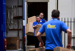 © Licensed to London News Pictures. 16/07/2016. London, UK. Boxes being placed in a van marked for David Cameron. Removal men begin to take items from numbers 10 and 11 at Downing Street at the end of the week that saw Prime Minister David Cameron leave and Theresa May arrive. Photo credit: Ben Cawthra/LNP